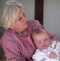 Picture of a grandmother holding her granddaughter
